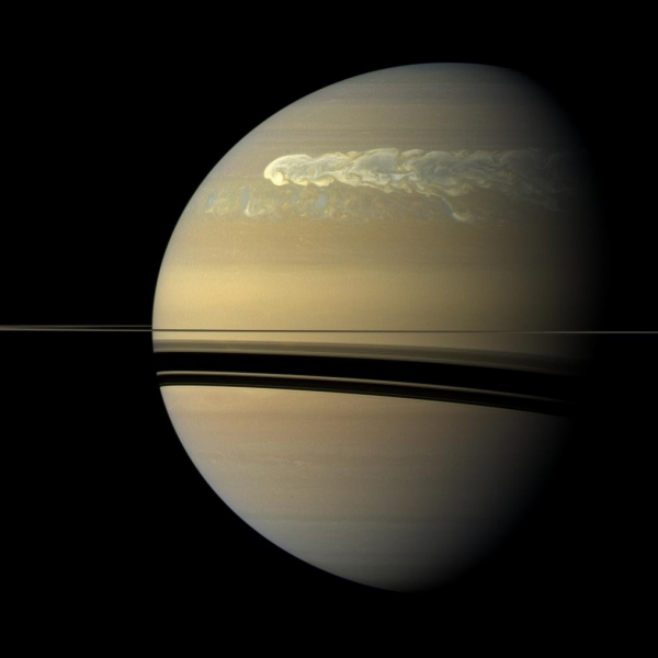 An enormous storm on Saturn completely encircles the giant planet.