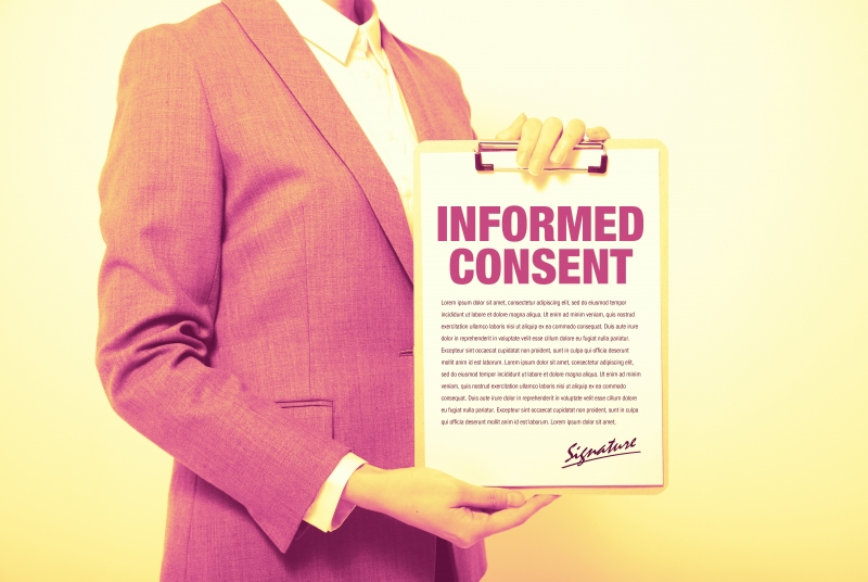 Stock photo of official displaying an informed consent agreement.