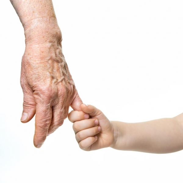 Grandparent and grandchild holding hands
