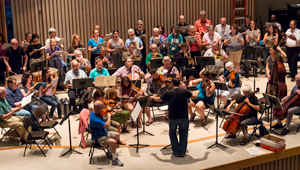 orchestra rehearsing with guest composer