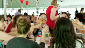 seniors around table raise glasses to toast