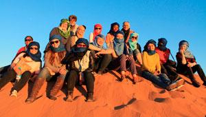 students on Sahara dune