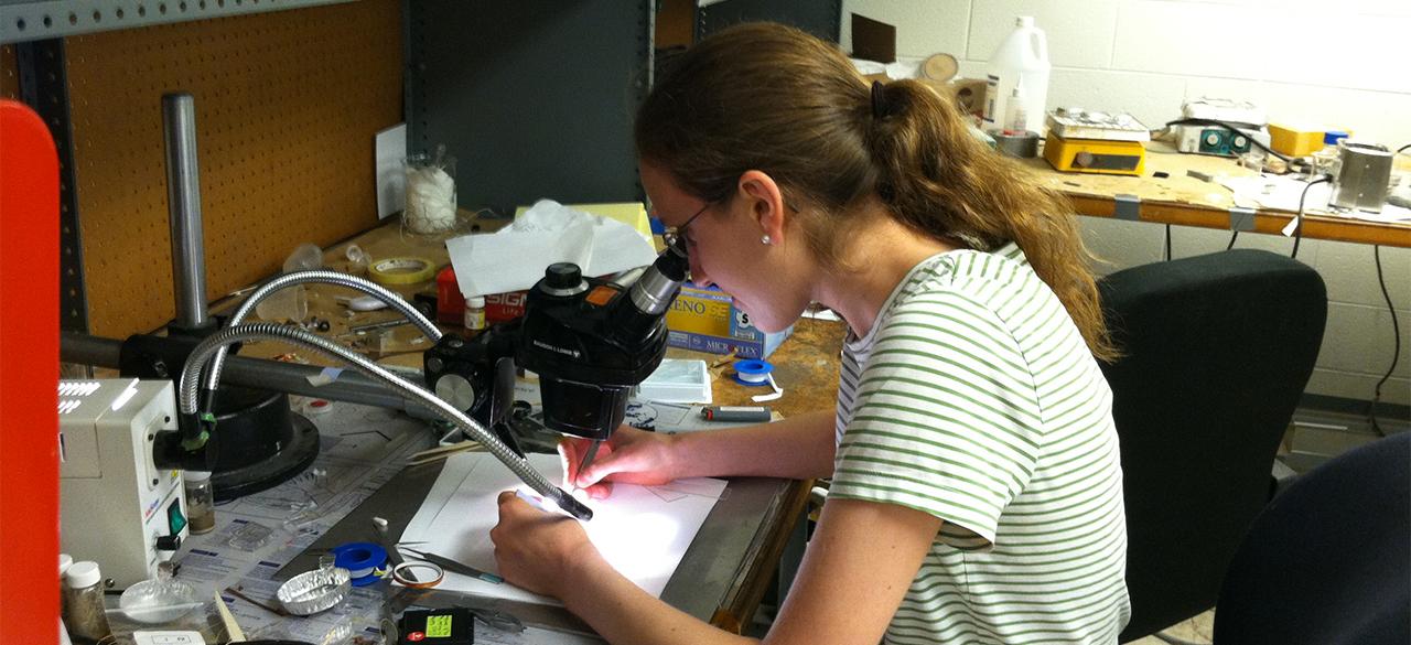 Photo of Carina Belvin '16 studying physics