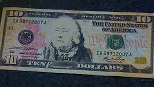 A $10 bill with the face of Education Reformer Elizabeth Peabody Superimposed