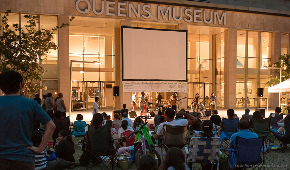 Outdoor evening event at the Queens Museum in NYC