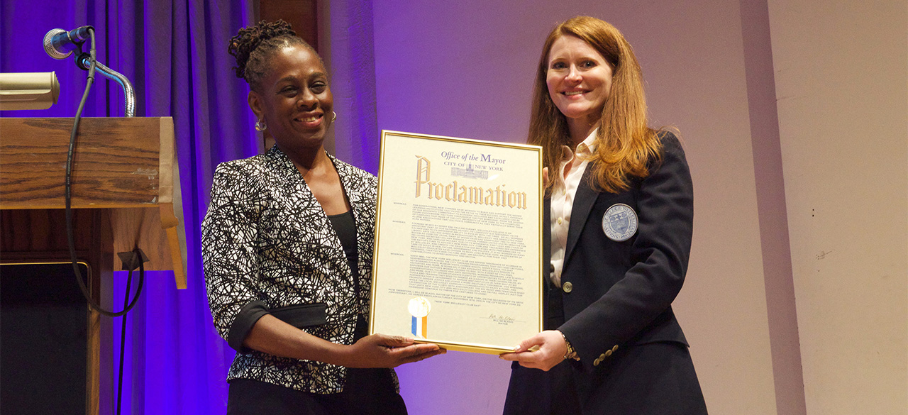"Chirlane McCray '76 presents Brooke Bryant '03 with a proclamation from Mayor Bill de Blasio declaring November 14, 2015 ""New York Wellesley Club Day."""
