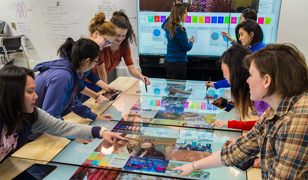 Students use MultiTaction display in Wellesley's Human Computer Interaction Lab