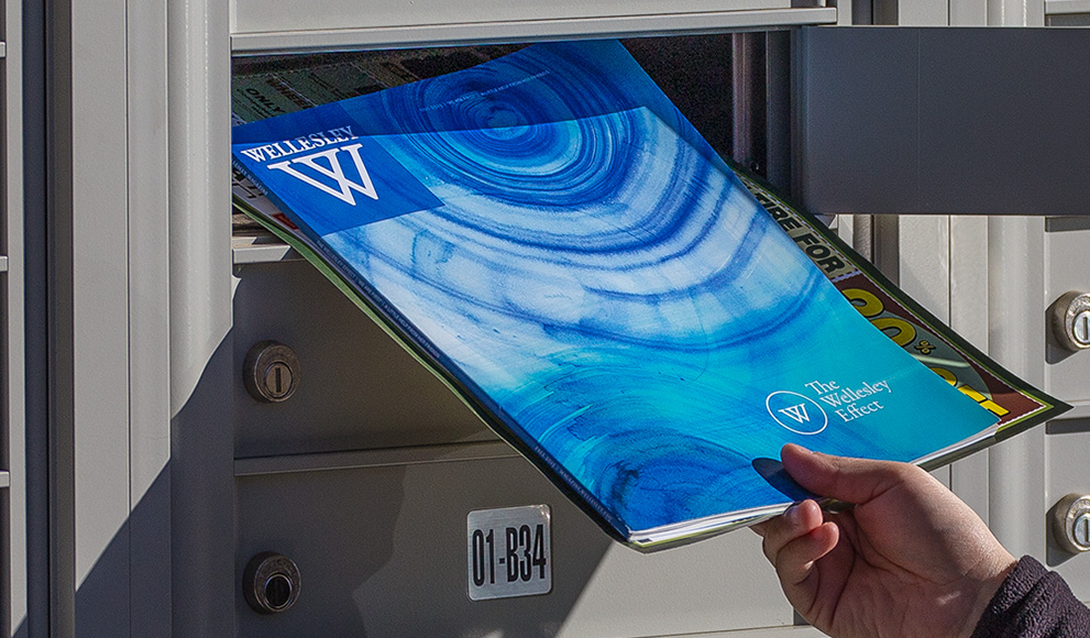 A hand pulls the Fall 2015 Wellesley magazine from a mailbox.