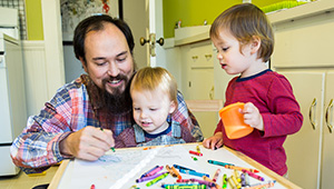 David Teng-Olsen, assistant professor of art, colors with his sons, Jack and Felix.