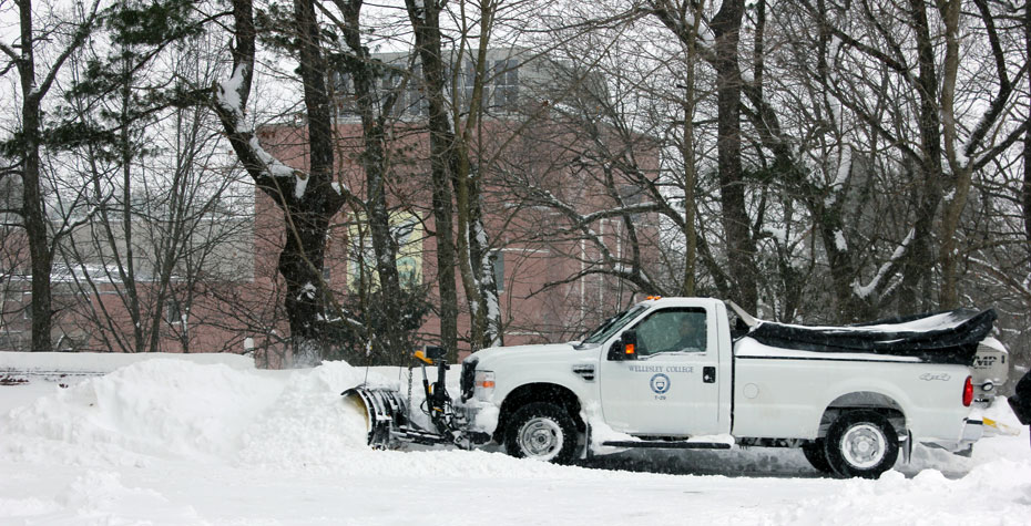 grounds crew plowing snow