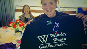 Madeleine Albright '59 holds a Wellesley t-shirt