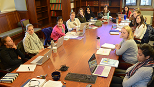 Wellesley students gathered around a classroom conference table.