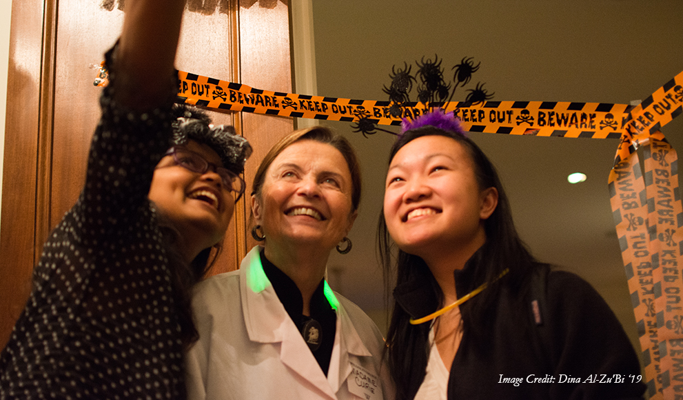"President Bottomly takes a ""selfie"" with trick or treating students"