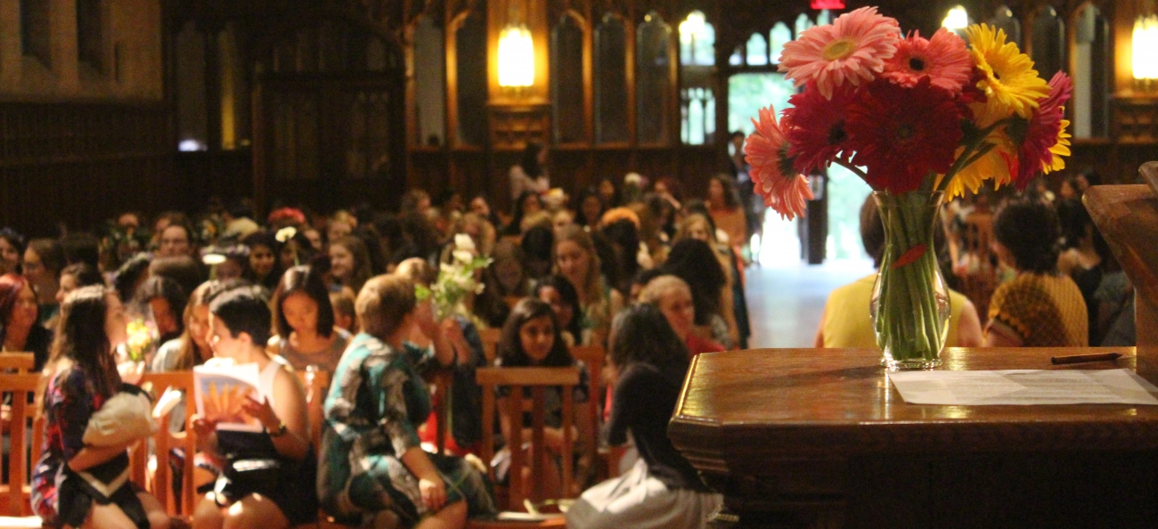 Flowers in the foreground, Houghton Chapel is filled for Flower Sunday