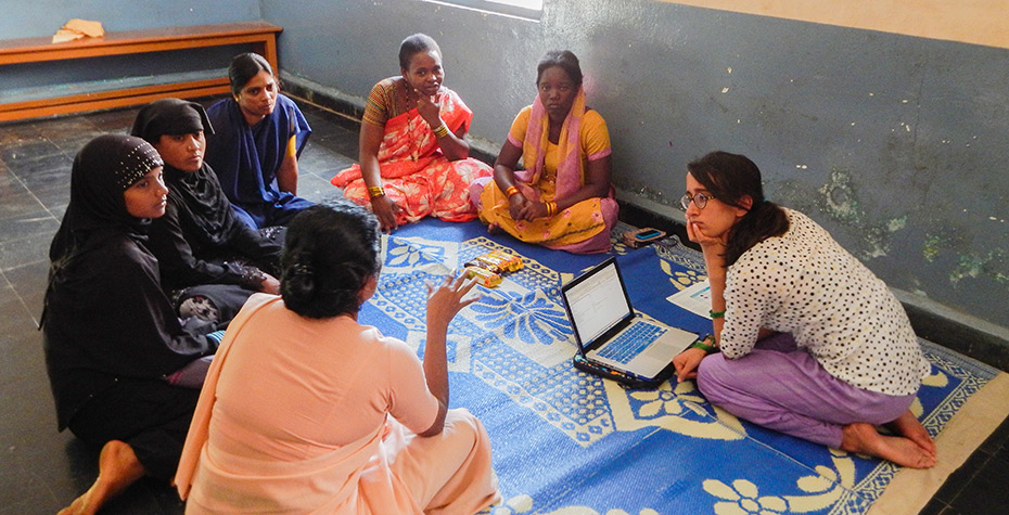 Wellesley College Student Jessica Saifee talks with a group of women in rural India
