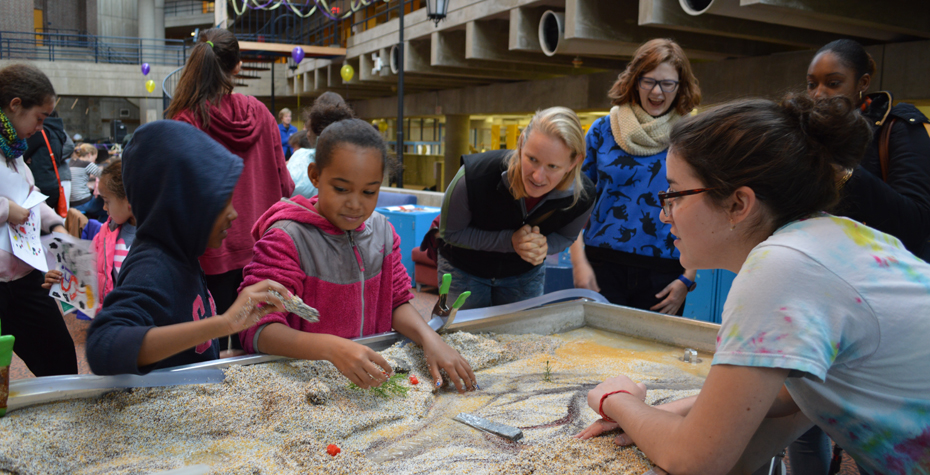 A Wellesley geosciences student demonstrates the importance of proper urban planning to Science Club for Girls students.