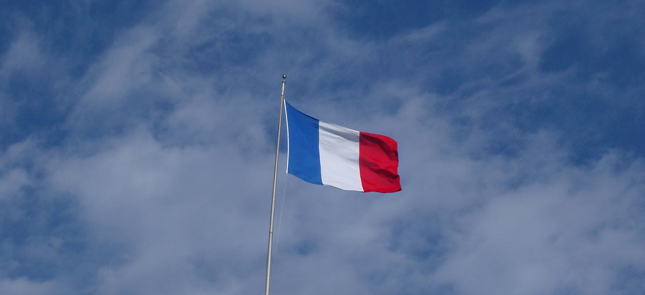 The French flag against blue sky