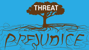 "An illustration of a tree reading ""threat"" with ""prejudice"" spelled by the roots"