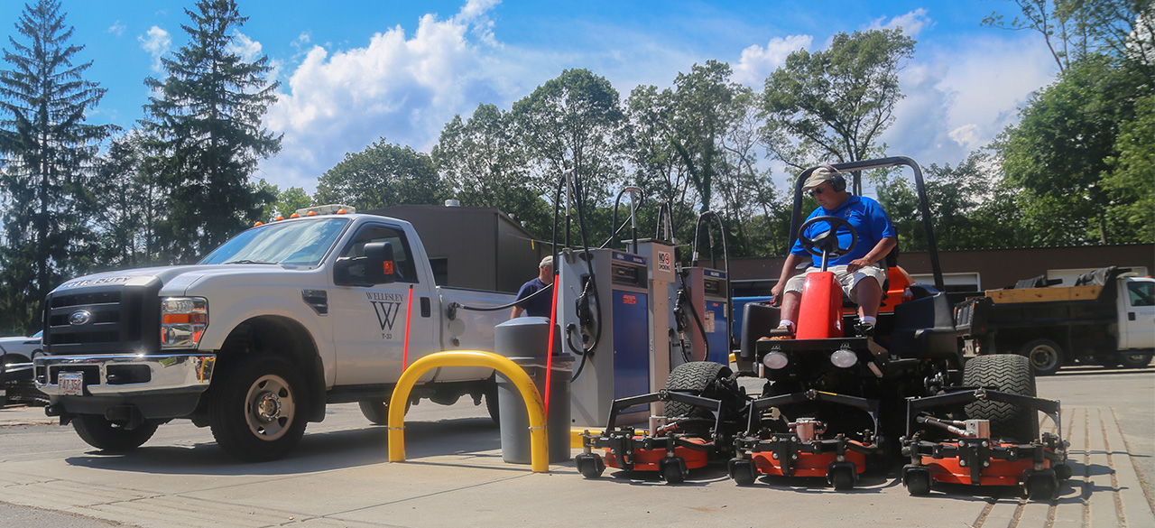Vehicles fuel up at Wellelsey's gas pumps