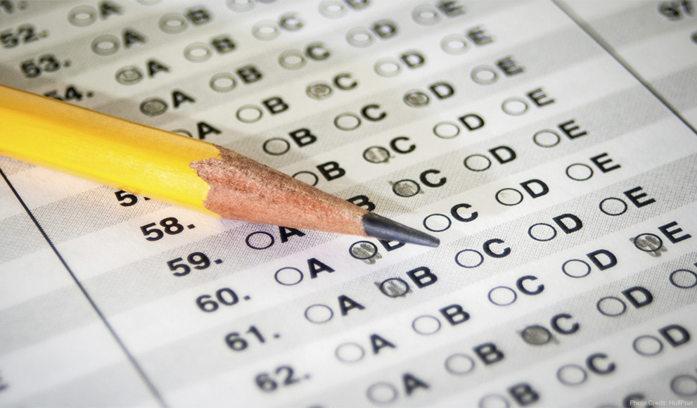 Pencil lays on a scantron style test, some bubbles are filled in.