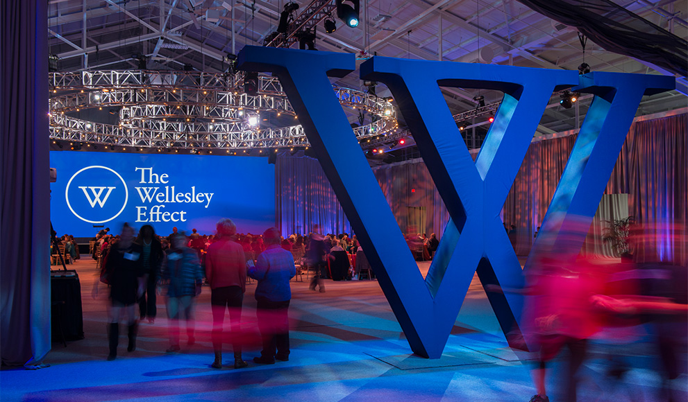 An interior photo of the Wellesley fieldhouse decorated for the launch of the Campaign for Wellesley