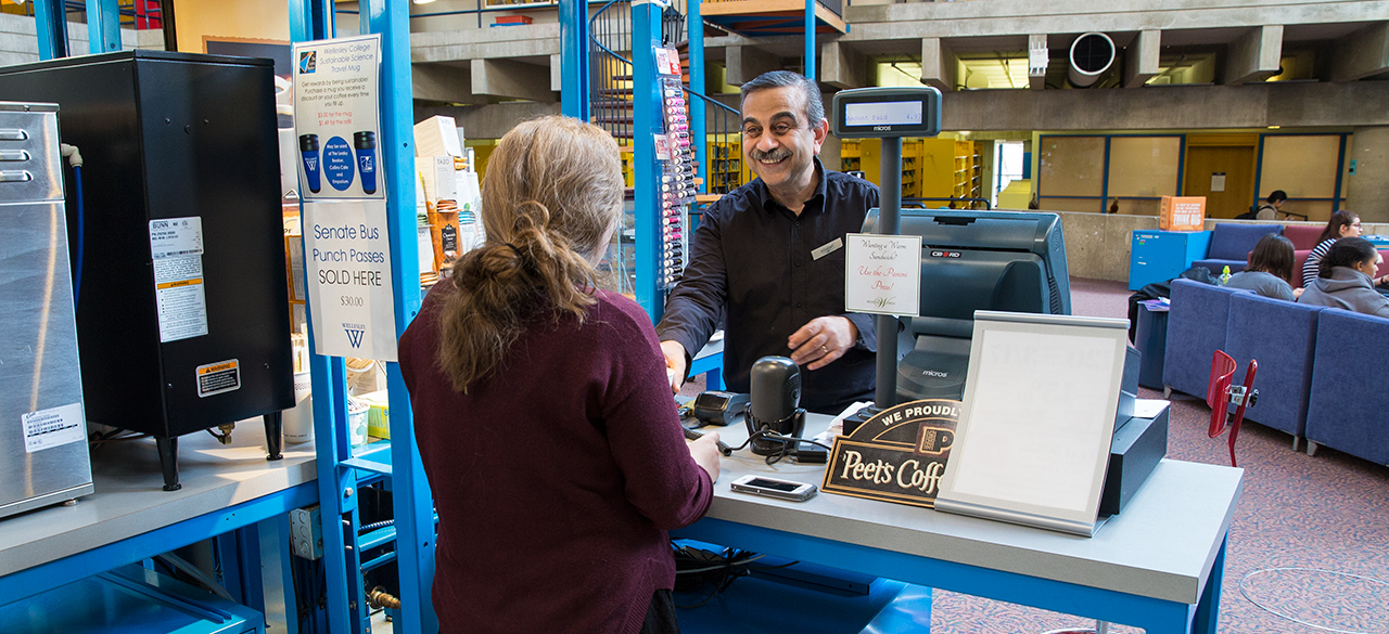 Ashraf Youssef serves a customer at the Leaky Beaker Cafe