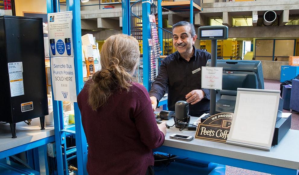 Ashraf Youssef serves a customer at the Leaky Beaker Cafe