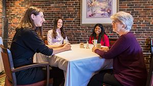 Students talk with Betty Pforzheimer '59