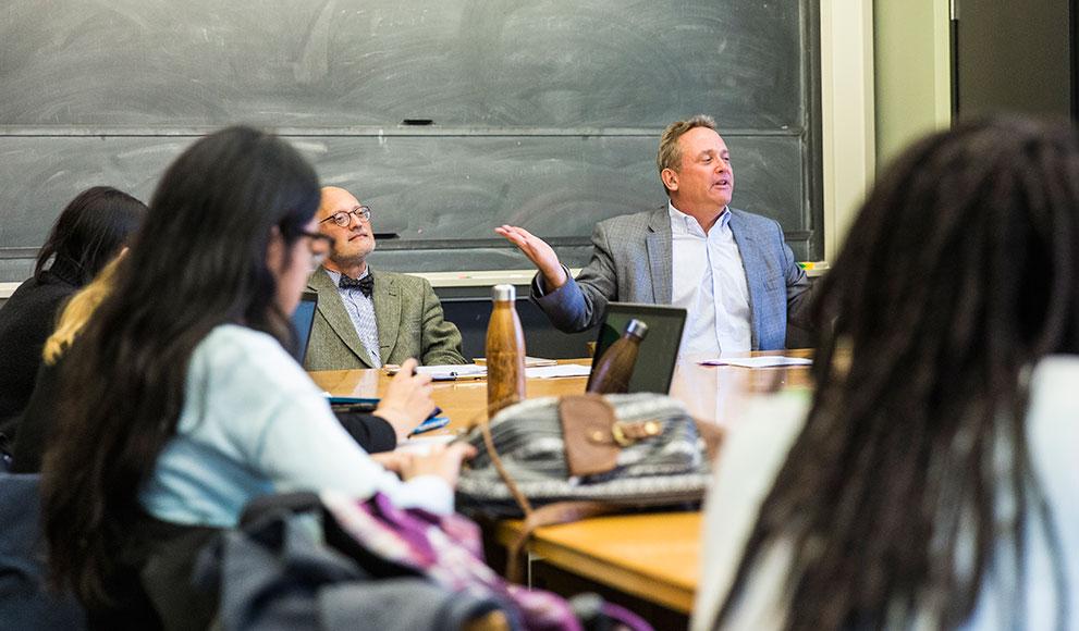 Professors Tom Cushman and Jonathan Imber lead a class.