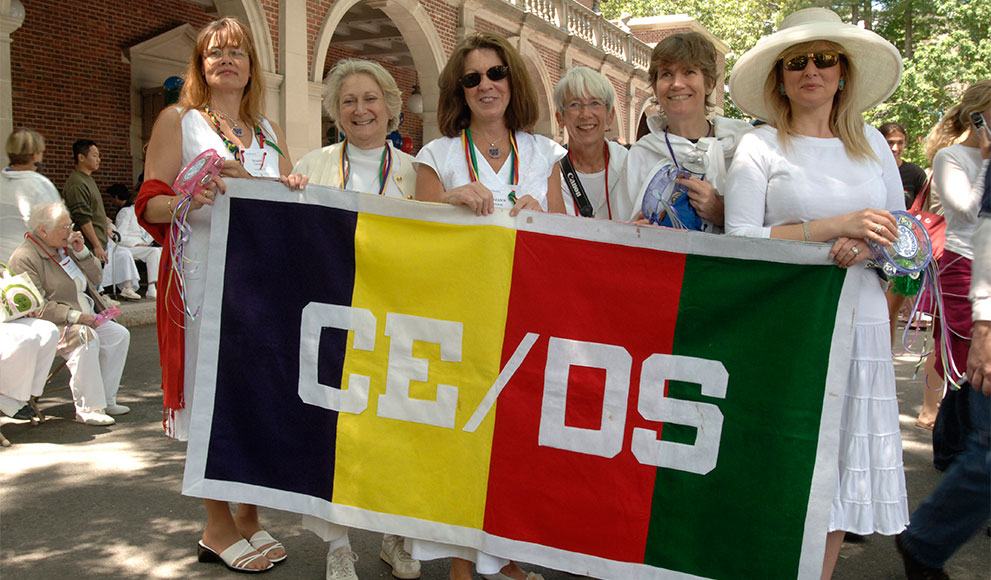 Continuing Education/Davis Scholar Alumnae hold a banner reading CE/DS