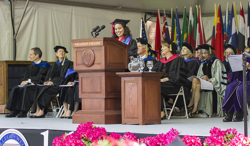 Delia Arias De Leon, co-president of the Class of 2016, introducing her fellow class co-president, and this year's student speaker, Grace Park.