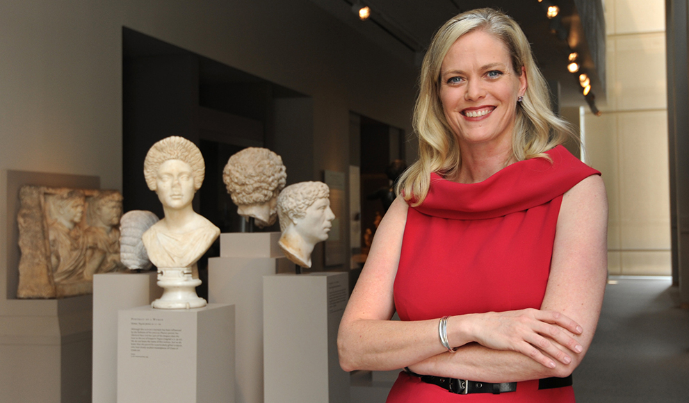 Julia Marciari-Alexander stands in front of sculptures at the Walters Art Museum in Baltimore.