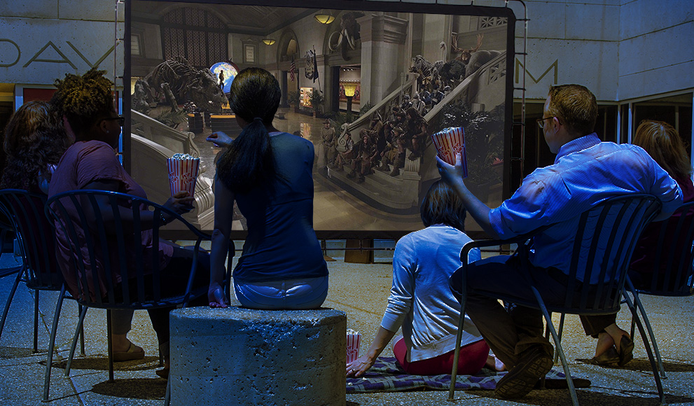 Crowd watches a film in the Davis Museum plaza.