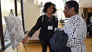 Alumnae view a photo at the Harambee House 45th Anniversary celebration