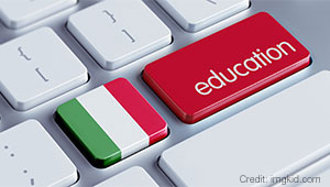A keyboard with one key that looks like an Italian flag and another that says education