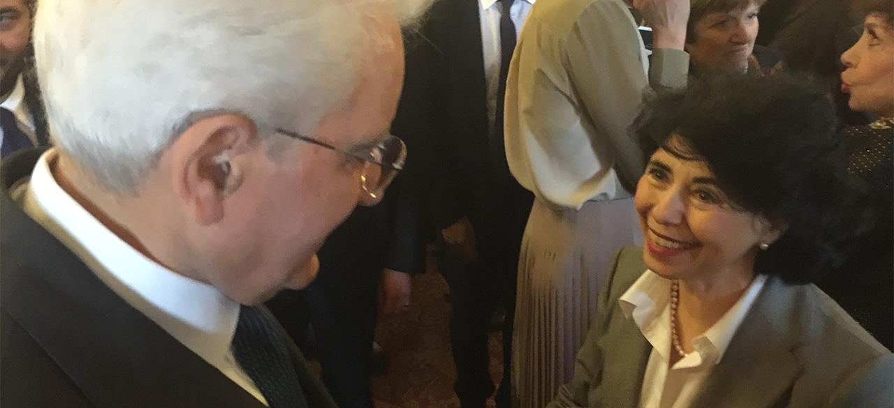 Senior Lecturer Flavia Laviosa is congratulated by Italian President Sergio Mattarella