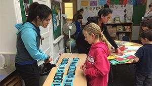 Elizabeth Hau '16, left, and a student at John D. Hardy Elementary School