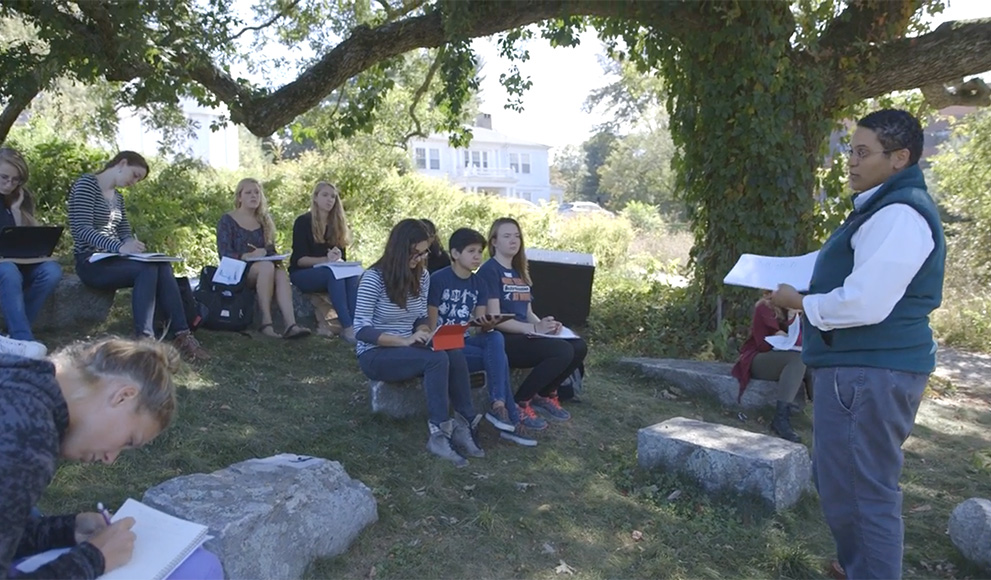 Monica Higgins, lecturer in environmental studies, teaches students outside
