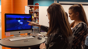 High school student tries one of the computers in Wellesley's HCI Lab.