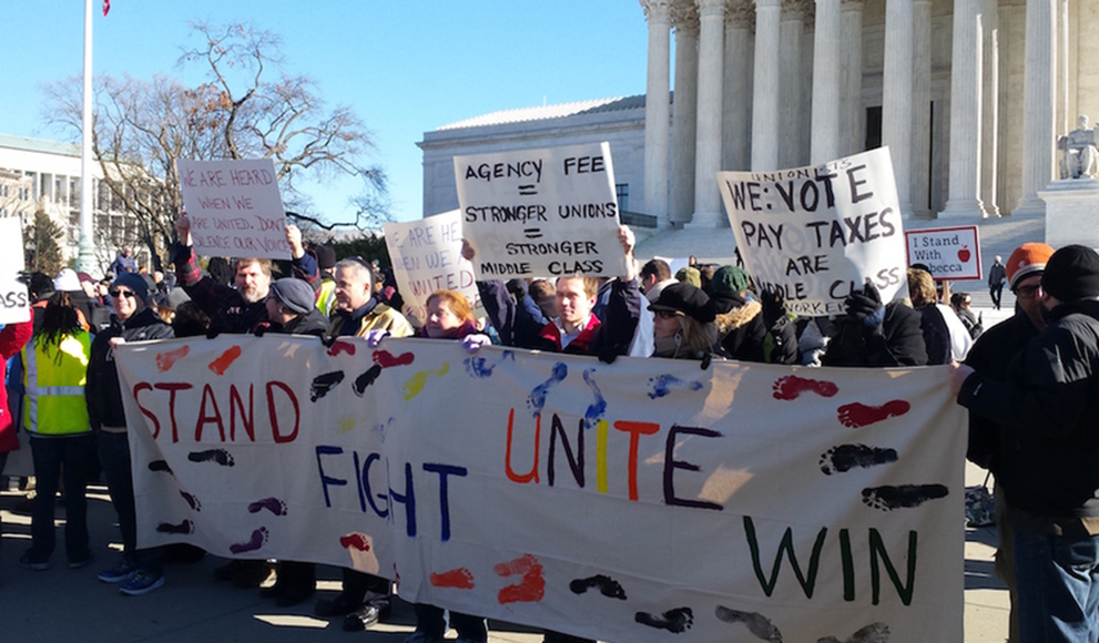 Protesters rally outside the Supreme Court as the court heard arguments in Friedrichs v. California Teachers Association