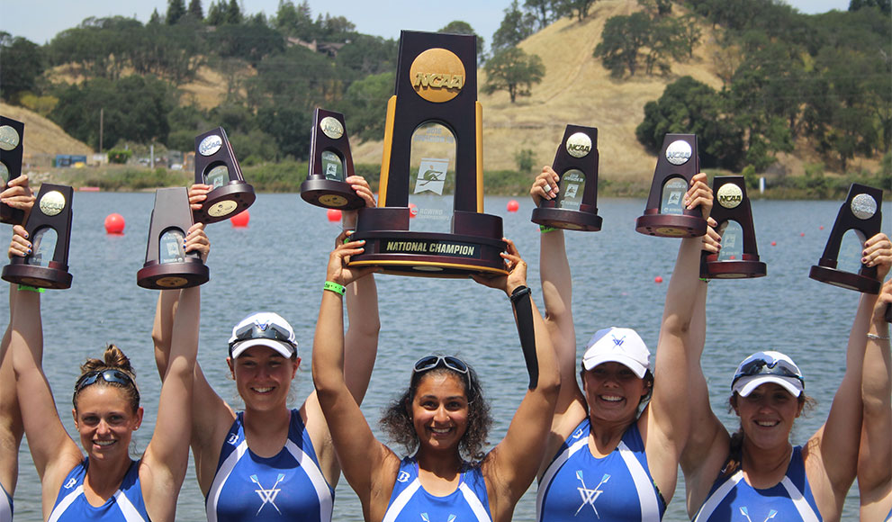 Wellesley Crew athletes lift their NCAA National Championship trophy