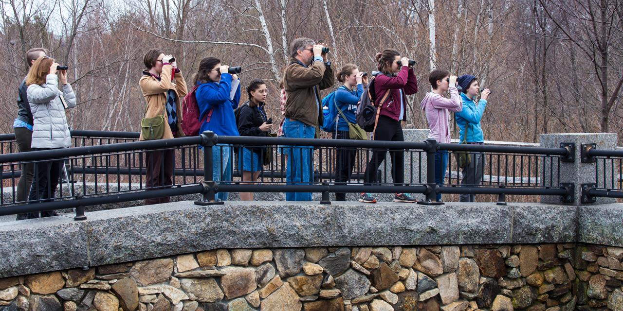 Nicholas Rodenhouse leads a bird walk around campus