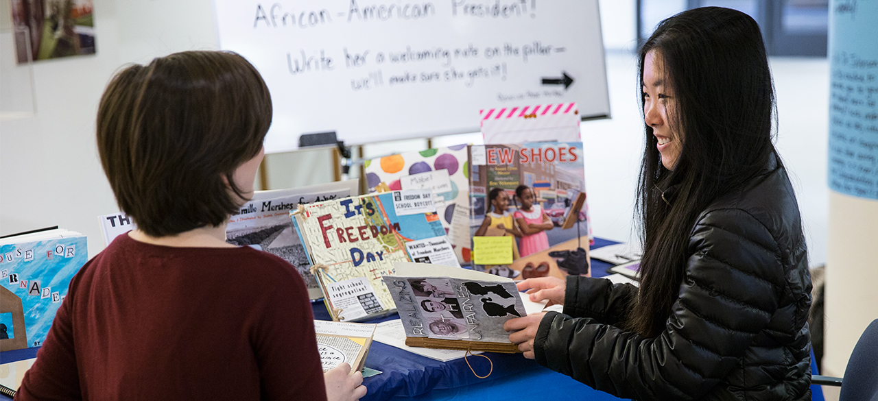 """A display of children's books written by Wellesley students for """"HIST 252 The Modern Black Freedom Struggle"""""""