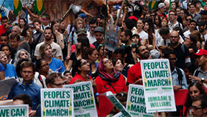 crowd with banners at NYC climate march