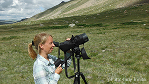 Kessler looks through spotting scope