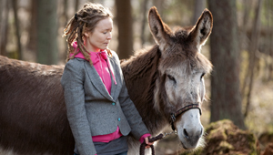 woman with donkey from aija-liisa ahtila's exhibition