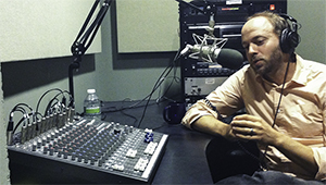 Adam Van Arsdale talks on radio set