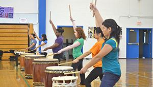 students in drumming practice