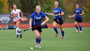 Wellesley field hockey players take ball upfield