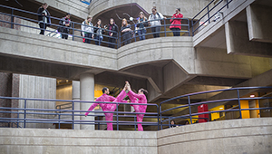 dancers in pink on science center walkway